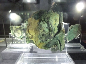 The largest fragment in the display case shows layers of gear wheels.