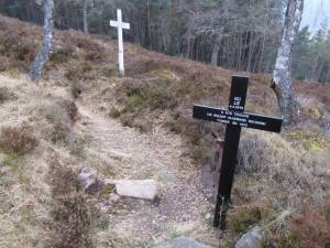 The brown cross marks the resting place of a German soldier whose remains were uncovered in 2010.
