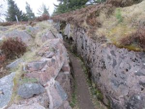 A trench fortified with concrete masonry.