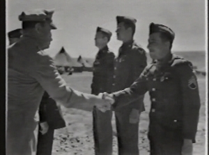 Harry (middle) receives the Purple Heart in Algeria, 1942. (Photo from Harry Marlow).